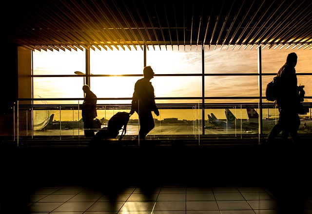 A man heading to his flight at the airport.